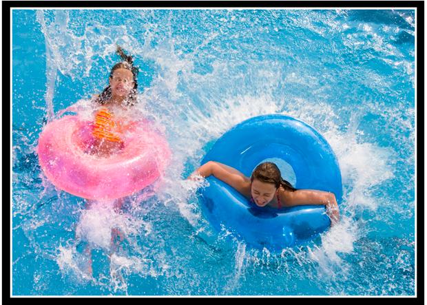 kids splashing in the pool